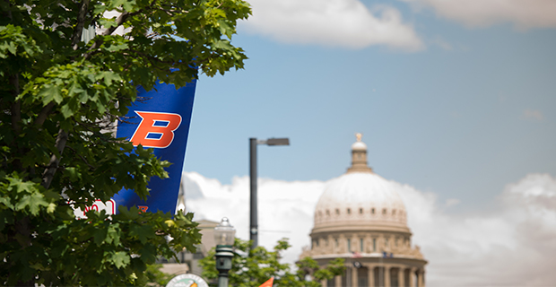 picture of the state capitol dome and the Boise State B flag